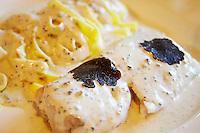 fish with tagliatelle pasta and creamy black truffles sauce rhone france