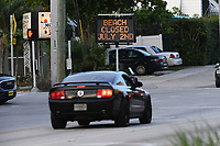 "FORT LAUDERDALE, FL - JUNE 29: A general view of a sign that reads ""Beach Closed July 2nd"" on Deerfield Beach as South Florida beaches are to close for July Fourth weekend, Florida reports another record spike in coronavirus cases, Florida's Covid-19 surge shows the state's reopening plan is not working on June 29, 2020 in Deerfield Beach, Florida. Credit: mpi04/MediaPunch"