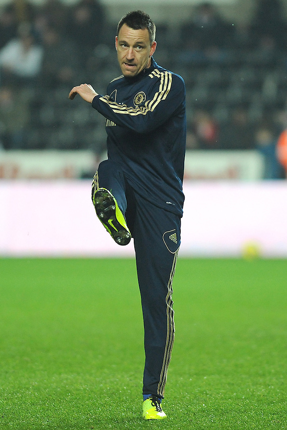 Chelsea's John Terry warming up prior to kick off . - Credit - CameraSport - Ian Cook - ..Football - Football -  Capital One Cup Semi-Final Second Leg - Swansea City v Chelsea - Wednesday 23rd January 2013 - Liberty Stadium - Swansea..
