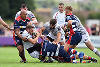 Rhys Priestland of Bath Rugby is tackled to ground. Pre-season friendly match, between Bristol Rugby and Bath Rugby on August 12, 2017 at the Cribbs Causeway Ground in Bristol, England. Photo by: Patrick Khachfe / Onside Images