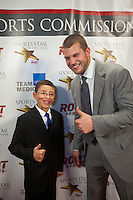 Seattle Children's Inspirational Youth Award winner Jake Finkbonner of Ferndale, WA and Tennessee Titans quarterback Jake Locker joke for the cameras on the red carpet before the 77th Annual Sports Star of the Year, presented by ROOT SPORTS, at Benaroya Hall in Seattle Wednesday, Jan. 27, 2012. The evening honors Northwest sports stars, carrying on an annual tradition started by Seattle Post-Intelligencer sports editor Royal Brougham in 1936. (Photography by Dan DeLong/Red Box Pictures)