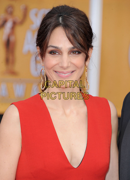 Annie Parisse.Arrivals at the 19th Annual Screen Actors Guild Awards at the Shrine Auditorium in Los Angeles, California, USA..27th January 2013.SAG SAGs headshot portrait red sleeveless dangling gold earrings .CAP/DVS.©DVS/Capital Pictures.