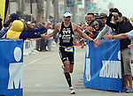 OCEANSIDE, CA - MARCH 31:  Andy Potts of the USA wins the California Ironman 70.3 on March 31, 2012 in Oceanside, California. (Photo by Donald Miralle).