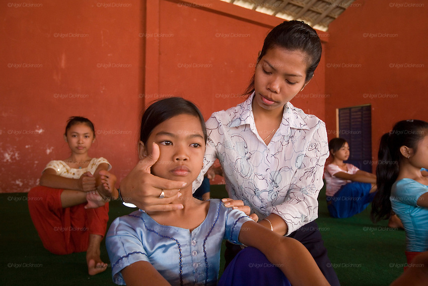 Chanthy wearing her beautiful costume, learns the complicated movements of Khmer Apsara dancing at the School of Beaux Arts. Her teacher pays special attention to her... Chanthy, a young girl, learns the Apsara traditional Khmer dance style, at the School of Beaux Arts outside Phnom Penh. This dance style is particularly inspired by thousands of Apsara statues found at Angkor Wat and performed by the Cambodia Royal Ballet. Chanthy lives with her family in Phnom Penh, her father is a policeman, and her family lives in a municipal apartment block surrounded by other families. Chanthy has good friends including a Chinese girl who is mentally handicapped and lives next door. She loves to visit Phnom Penh city and sites with her mother and father, on his scooter.