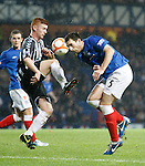 Lee Wallace gets a sore one from Cieran MacLean as the Rangers defender puts his head in harms way