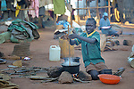 A girl stirs a pot of food she cooks over a fire in a camp for over 5,000 internally displaced persons in an Episcopal Church compound in Wau, South Sudan. Most of the families here were displaced by violence early in 2017, after a larger number took refuge in other church sites when widespread armed conflict engulfed Wau in June 2016.<br /> <br /> Norwegian Church Aid, a member of the ACT Alliance, has provided relief supplies to the displaced in Wau, and has supported the South Sudan Council of Churches as it has struggled to mediate the conflict in Wau.