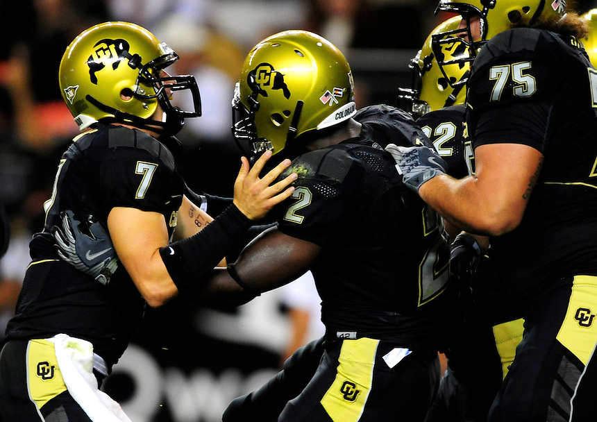 31 Aug 2008: Colorado quarterback Cody Hawkins (7) and center Daniel Sanders (75) celebrate a touchdown by running back Darrell Scott (center) against Colorado State. The Colorado Buffaloes defeated the Colorado State Rams 38-17 at Invesco Field at Mile High in Denver, Colorado. FOR EDITORIAL USE ONLY