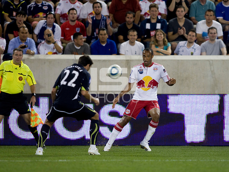 Verdan Corluka (22) of Tottenham tries to challenge the cross of Thierry Henry (14) of the New York Red Bulls during the Barclays New York Challenge at Red Bull Arena in Harrison, NY.  Tottenham defeated the New York Red Bulls, 2-1.
