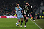 Saul Niguez of Atletico Madrid and Mattia De Sciglio of Juventus race after the ball during the UEFA Champions League match at Juventus Stadium, Turin. Picture date: 26th November 2019. Picture credit should read: Jonathan Moscrop/Sportimage