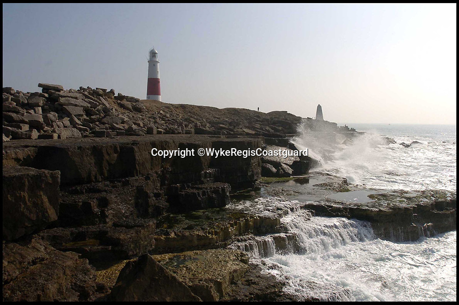 BNPS.co.uk (01202 558833)Pic: WykeRegisCoastguard/BNPS<br /> <br /> Portland Bill in Dorset.<br /> <br /> A driver had a miraculous escape after his car plunged off a 25ft cliff into jagged rocks at Portland Bill last night with a high tide coming in.<br /> <br /> The vehicle came off the road in Portland, Dorset at about 11.15pm last night and ended up on its side near crashing waves and near freezing conditions.<br /> <br /> More than 40 police, fire, lifeboat and coastguard crew battled for more than two hours to free the driver, a man in his 50s, during the 'precarious' rescue.<br /> <br /> Time was of the essence as high tide was coming in and the car and its occupant could have been swept out to sea.