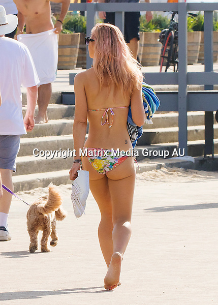 11 OCTOBER 2015 SYDNEY <br /> AUSTRALIA<br /> <br /> EXCLUSIVE PICTURES<br /> <br /> Jessica Marais pictured power walking along Bondi Beach in a skimpy bikini showing off her yoga toned body with her new pink hair style. <br /> <br /> *ALL WEB USE MUST BE CLEARED*<br /> <br /> Please contact prior to use:  <br /> <br /> +61 2 9211-1088 or email images@matrixmediagroup.com.au <br /> <br /> Note: All editorial images subject to the following: For editorial use only. Additional clearance required for commercial, wireless, internet or promotional use.Images may not be altered or modified. Matrix Media Group makes no representations or warranties regarding names, trademarks or logos appearing in the images.