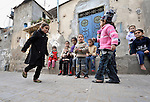 Children playing hopscotch in the Nuseirat refugee camp in the middle of the Gaza strip. .
