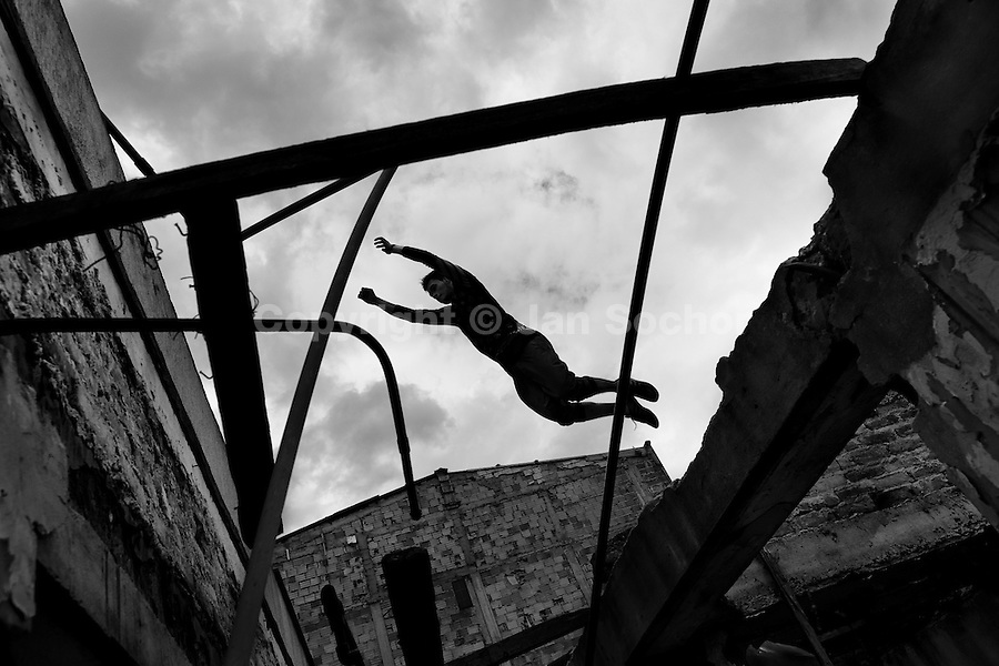A Colombian parkour runner jumps over a gap inside an abandoned house during a free running training session of Plus Parkour team in Bogotá, Colombia, 22 February 2016. Parkour, originally developed in France during the late 1980s from military training, is a physical activity, focused on the art of movement and overcoming obstacles in a strictly urban environment. Practitioners of parkour employ running, climbing, jumping, rolling and other movements to pass through any urban area the most efficient way possible.