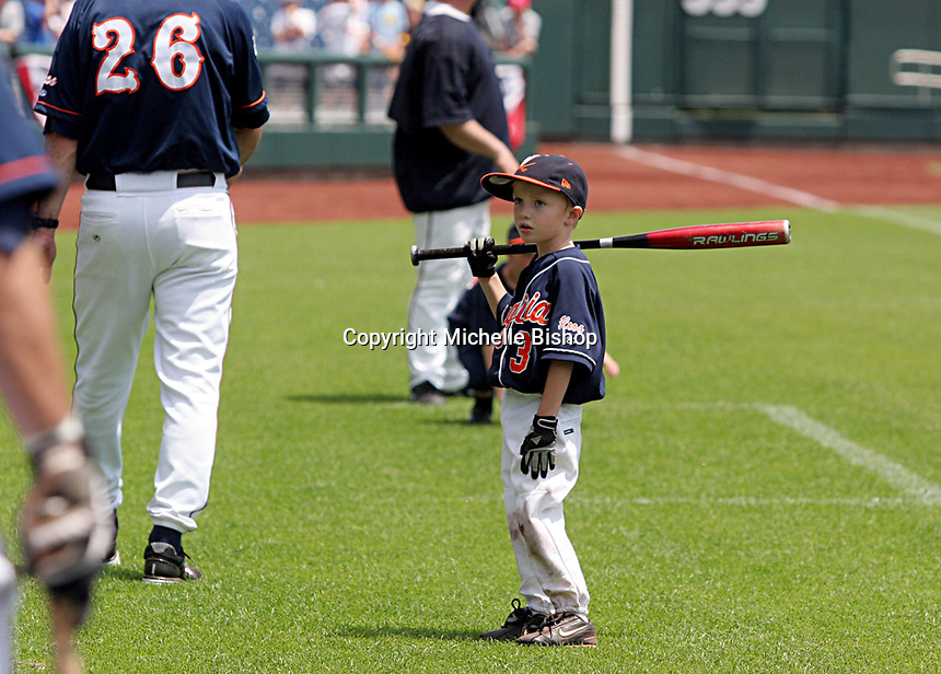 A young Virginia baseball fan looks on as the Cavaliers prepare to practice at TD Ameritrade Park for their opening game of the 2011 College World Series. (Photo by Michelle Bishop)..