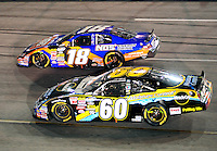 May 1, 2009; Richmond, VA, USA; NASCAR Nationwide Series driver Carl Edwards (60) races alongside Kyle Busch (18) during the Lipton Tea 250 at the Richmond International Raceway. Mandatory Credit: Mark J. Rebilas-