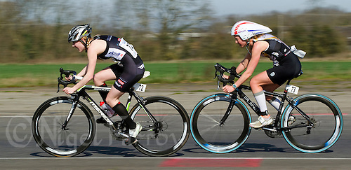 25 MAR 2012 - LOUGHBOROUGH, GBR - Lucy Gossage (TFN) (on right) drafts Racheal Bamford (Dirtwheels Cycles / LBT) (on left) during the women's 2012 British Elite Duathlon Championships at Prestwold Hall Airfield in Prestwold near Loughborough, Great Britain .(PHOTO (C) 2012 NIGEL FARROW)