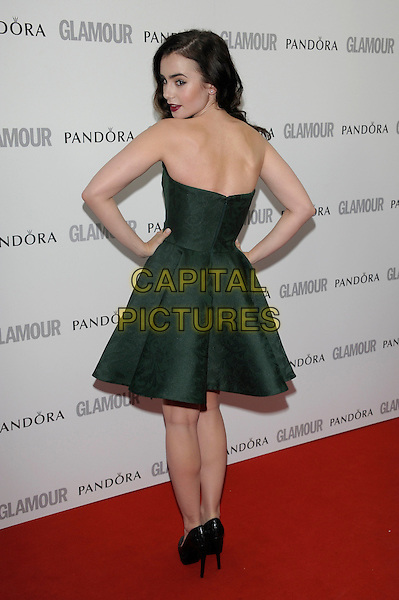 Lily Collins.The Glamour Women Of The Year Awards 2012, Berkeley Square Gardens, Berkeley Square, London, England..May 29th, 2012.full length dress green strapless hands on hips looking over shoulder back behind rear.CAP/PL.©Phil Loftus/Capital Pictures.