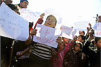 "Pictured: Children holding pieces of paper with ""Open Borders"" slogans Thursday 03 March 2016<br /> Re: Migrants have closed off the railway track at the Greek Fyro Macedonian border in Idomeni, Greece,"