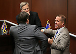 Nevada Senate Republicans Michael Roberson, front, and Greg Brower, rear, and Lt. Gov. Mark Hutchison talk on the Senate floor at the Legislative Building in Carson City, Nev., on Wednesday, April 15, 2015.<br /> Photo by Cathleen Allison