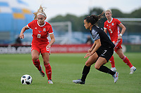 Charlie Estcourt of Wales Women's' vies for possession with Ali Riley of New Zealand Women's during the Women's International Friendly match between Wales and New Zealand at the Cardiff International Sports Stadium in Cardiff, Wales, UK. Tuesday 04 June, 2019