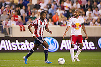 Oswaldo Minda (8) of CD Chivas USA. The New York Red Bulls and CD Chivas USA played to a 1-1 tie during a Major League Soccer (MLS) match at Red Bull Arena in Harrison, NJ, on May 23, 2012.