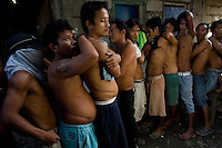 Men from the Basico port area slum of Manila show their scars from operations where they have donated thir kidneys. All recieved between 70,000 -  90,000 pesos (800 - 1030 pounds).  More than 300 have sold their kidneys in this slum of 16,000 people.<br />