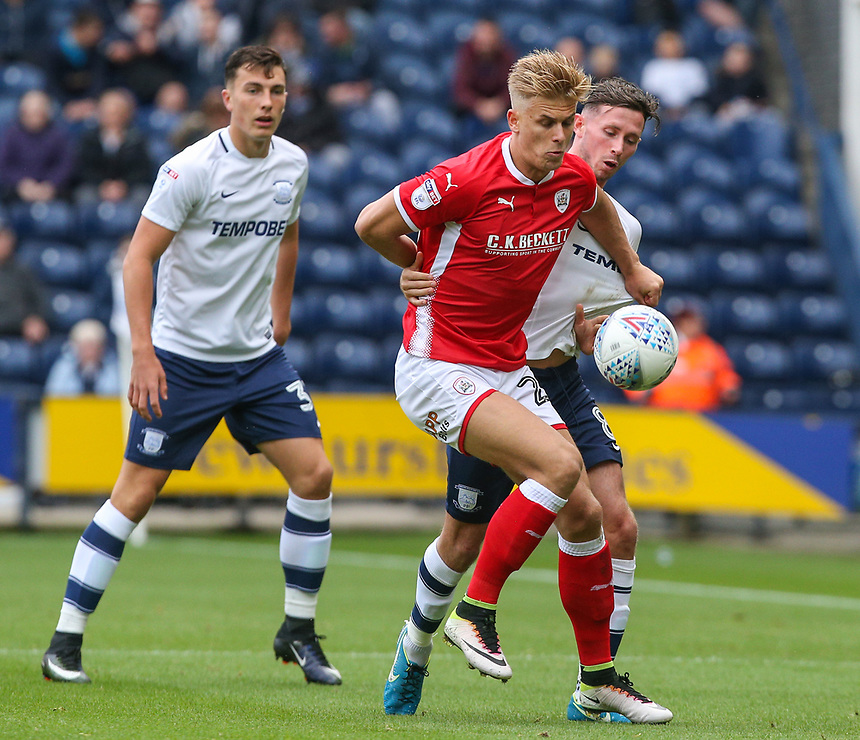 Preston North End's Alan Browne vies for possession with Barnsley's Brad Potts<br /> <br /> Photographer Alex Dodd/CameraSport<br /> <br /> The EFL Sky Bet Championship - Preston North End v Barnsley - Saturday 9th September 2017 - Deepdale Stadium - Preston<br /> <br /> World Copyright &copy; 2017 CameraSport. All rights reserved. 43 Linden Ave. Countesthorpe. Leicester. England. LE8 5PG - Tel: +44 (0) 116 277 4147 - admin@camerasport.com - www.camerasport.com