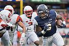 November 17, Tony Jones Jr. gains yardage during the Shamrock Series football game against Syracuse in Yankee Stadium, New York. (Photo by Barbara Johnston/University of Notre Dame)