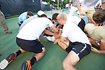Bar Botzer (bottom of the pile) of the Wake Forest Demon Deacons is mobbed by his teammates after his win at #4 singles clinched the 2018 NCAA Men's Tennis Championship over the Ohio State Buckeyes at the Wake Forest Tennis Center on May 22, 2018 in Winston-Salem, North Carolina.  The Demon Deacons defeated the Buckeyes 4-2. (Brian Westerholt/Sports On Film)