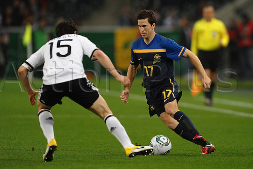 18 03 2011 International match Germany versus Australia  in Moenchengladbach Christian Trasch Germany left and Matthew McKay Australia right .