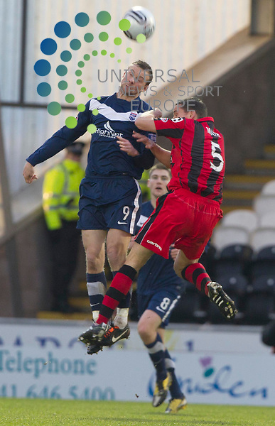 Colin McMenamin takes on Lee Mair of Ross during the St Mirren v Ross County William Hill Scottish Cup round Five..Picture: Maurice McDonald/Universal News And Sport (Scotland). 4 February 2012. www.unpixs.com.