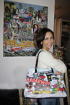 """Lauri Landry """"Nicole Love"""" - Another World and Broadway showing off Jane Elissa's purse as she raises money for Leukemia and Cancer Research. (Photo by Sue Coflin/Max Photos)"""