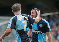 Michael Harriman of Wycombe Wanderers celebrates with Garry Thompson of Wycombe Wanderers after scoring his first goal during the Sky Bet League 2 match between Wycombe Wanderers and Hartlepool United at Adams Park, High Wycombe, England on 5 September 2015. Photo by Andy Rowland.