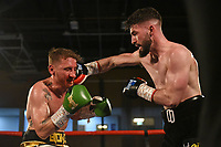 Jake Best (white/gold shorts) defeats Owen Duffy at the Woodside Leisure Centre on 9th March 2019