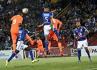 BOGOTA - COLOMBIA -27 -10-2015: Deiver Machado (2Izq.) y Andres Cadavid (Der.) jugadores de Millonarios disputan el balón con Jose Guerra (Izq.) jugador de Envigado FC, durante partido entre Millonarios y Jaguares FC, por la fecha 17 de la Liga Aguila II-2015, jugado en el estadio Nemesio Camacho El Campin de la ciudad de Bogota. / Deiver Machado (2L) and Andres Cadavid (L) players of Millonarios vie for the ball with Jose Guerra (L) player of Envigado FC, during a match between Millonarios and Jaguares FC, for the date 17 of the Liga Aguila II-2015 at the Nemesio Camacho El Campin Stadium in Bogota city. Photo: VizzorImage / Luis Ramirez / Staff.