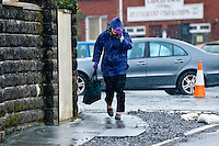 Friday 14 February 2014<br /> Pictured:A Woman brves the wind and Rain in Laugharne, West Wales<br /> Re: Rain and gale force winds are again due to batter the UK