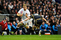 Chris Robshaw of England hands off Stuart Hogg of Scotland during the RBS 6 Nations match between England and Scotland at Twickenham on Saturday 02 February 2013 (Photo by Rob Munro)