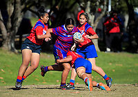 Jayme Latu (Richmond) is tackled during the Auckland Rugby League Girls Pilot under-17 match between Otara Scorpions and Richmond at Ngati Otara Park in Auckland, New Zealand on Saturday, 9 June 2018. Photo: Dave Lintott / lintottphoto.co.nz