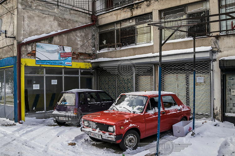Cars parked outside a building.