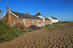 Beach housing on the coast, Shingle Street, Suffolk, England, UK