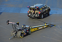 Apr. 13, 2012; Concord, NC, USA: Crew members tow the car of NHRA top fuel dragster driver Morgan Lucas out of the pits during qualifying for the Four Wide Nationals at zMax Dragway. Mandatory Credit: Mark J. Rebilas-