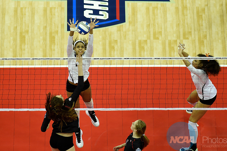 COLUMBUS, OH - DECEMBER 17:  Morgan Johnson (12) of the University of Texas jumps for a block against Stanford University during the Division I Women's Volleyball Championship held at Nationwide Arena on December 17, 2016 in Columbus, Ohio.  Stanford beat Texas 3-1 to win the national title. (Photo by Jamie Schwaberow/NCAA Photos via Getty Images)
