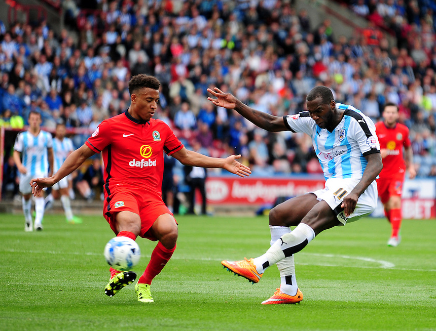 Huddersfield Town's Ishmael Miller gets a shot away under pressure from Blackburn Rovers' Adam Henley<br /> <br /> Photographer Andrew Vaughan/CameraSport<br /> <br /> Football - The Football League Sky Bet Championship - Huddersfield Town v Blackburn Rovers - Saturday 15th August 2015 - The John Smith's Stadium - Huddersfield<br /> <br /> &copy; CameraSport - 43 Linden Ave. Countesthorpe. Leicester. England. LE8 5PG - Tel: +44 (0) 116 277 4147 - admin@camerasport.com - www.camerasport.com