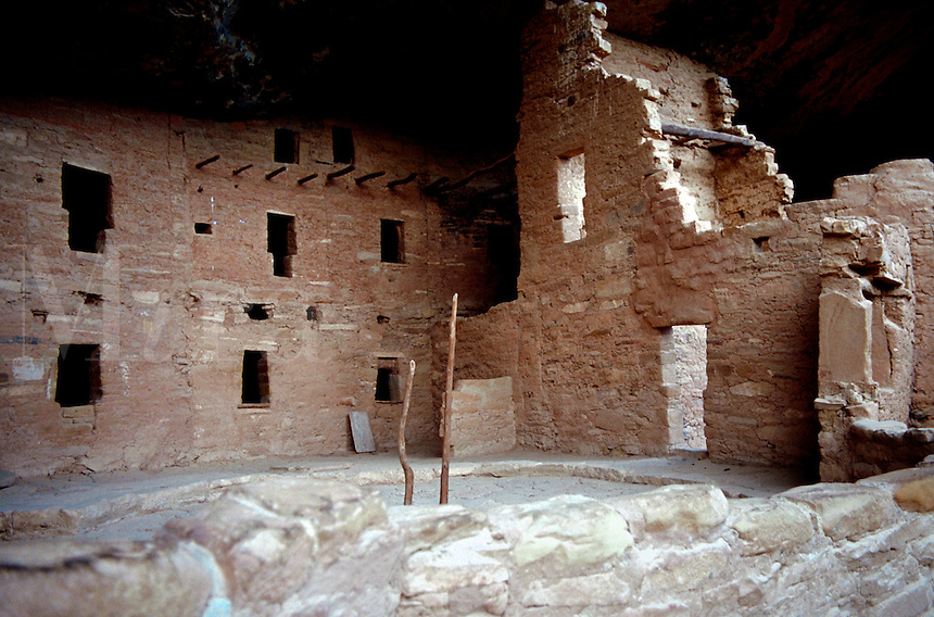 An interior view of Spruce Tree House - an Anasazi Indian cliff dwelling. The poles are part of ladders leading to kivas - ceremonial chambers. Mesa Verde National Park, Colorado.