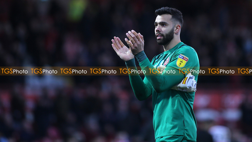 Brentford goalkeeper, David Raya applauds the home fans at the final whistle during Brentford vs Middlesbrough, Sky Bet EFL Championship Football at Griffin Park on 8th February 2020