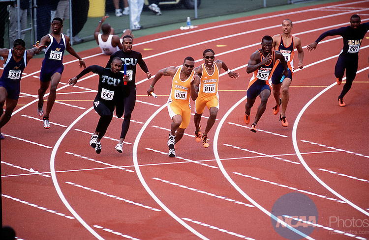 01 June 2001:  The baton is passed from the third leg to the final leg in the Men's 4x100m relay as TCU wins and Tennessee finishes 2nd and UTEP comes in 3rd at the 2001 NCAA Division 1 Men's & Women's Outdoor Track & Field Championships held at Hayward Field on the campus of the University of Oregon, Eugene, OR. © Rich Clarkson / NCAA Photos
