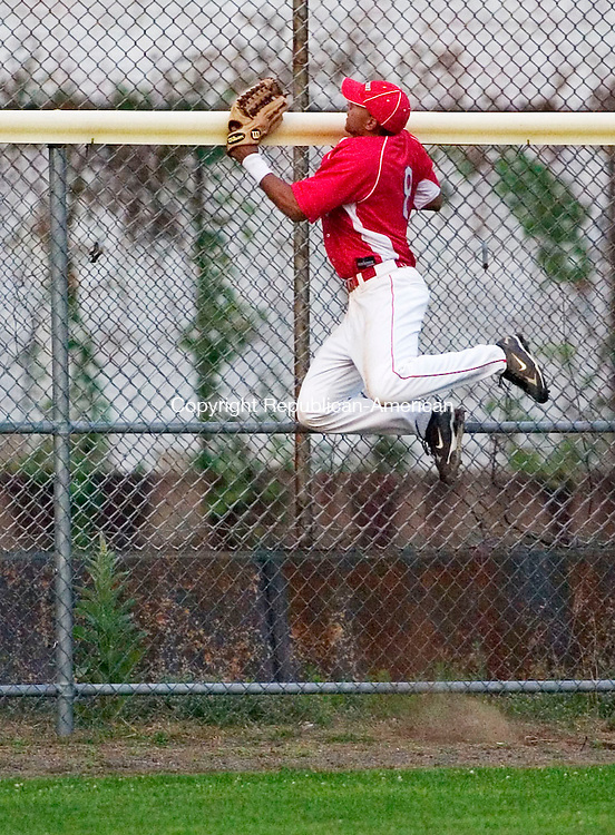TORRINGTON, CT- 08 JULY 2008- 070808JT06-<br /> Dominican Team's Willie Rojas jumps to the edge of the fence as he watches a home run hit by the Twisters' Austin Chase during Tuesday's exhibition game at Fuessenich Park.<br /> Josalee Thrift / Republican-American