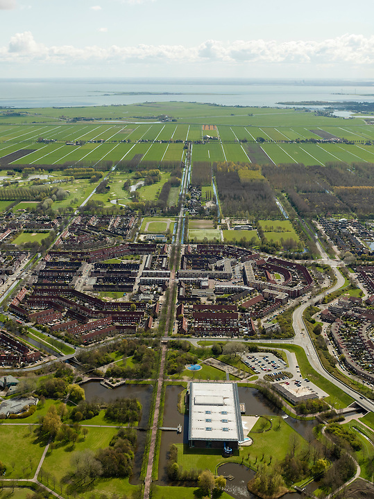 Nederland, Noord-Holland, Gemeente Purmerend, 16-04-2012; zicht op polder De Purmer langs de as van de Purmerenderweg, links de wijk Purmer-Noord, rechts de Purmer-Zuid. Op het tweede plan van links naar rechts: golfterrein, Purmerbuurt, Purmerbos. In de achtergrond de oorspronkelijke verkaveling van de polder langs de Oosterweg..View on polder the Purmer and the city of Purmerend. In the back the Markermeer (lake). .luchtfoto (toeslag), aerial photo (additional fee required);.copyright foto/photo Siebe Swart