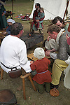 Saxon family group playing board game, Living History event, Sutton Hoo, Suffolk, England