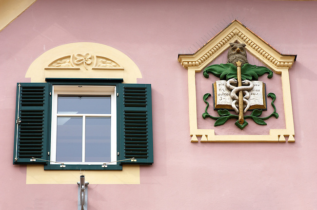 Baroque window and apocathary crest on a house Hartberg Austria